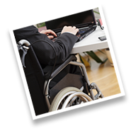 Person in wheelchair working at desk